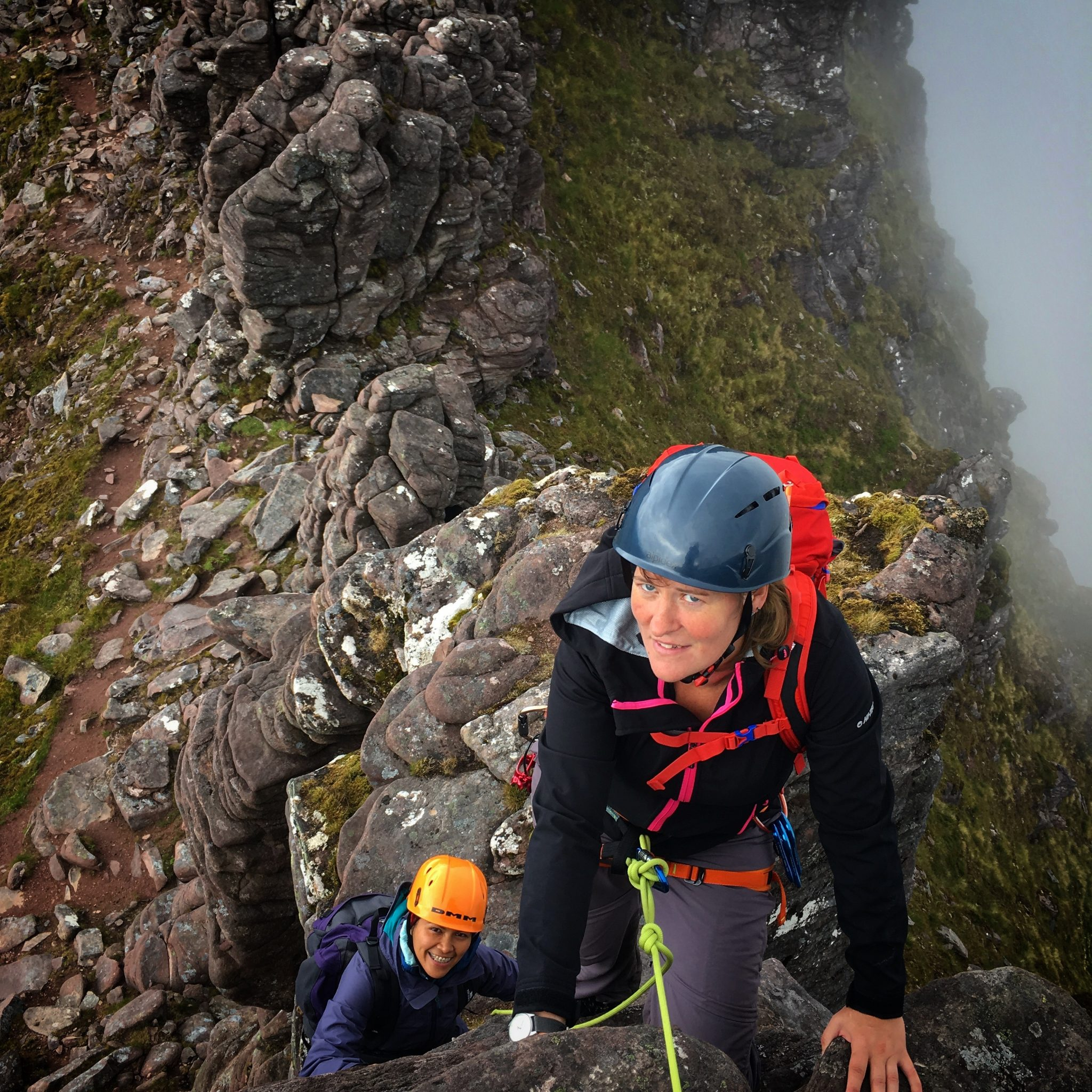Scramblers traversing the Corrag Bhuidhe pinnacles on An Teallach during a mountaineering course