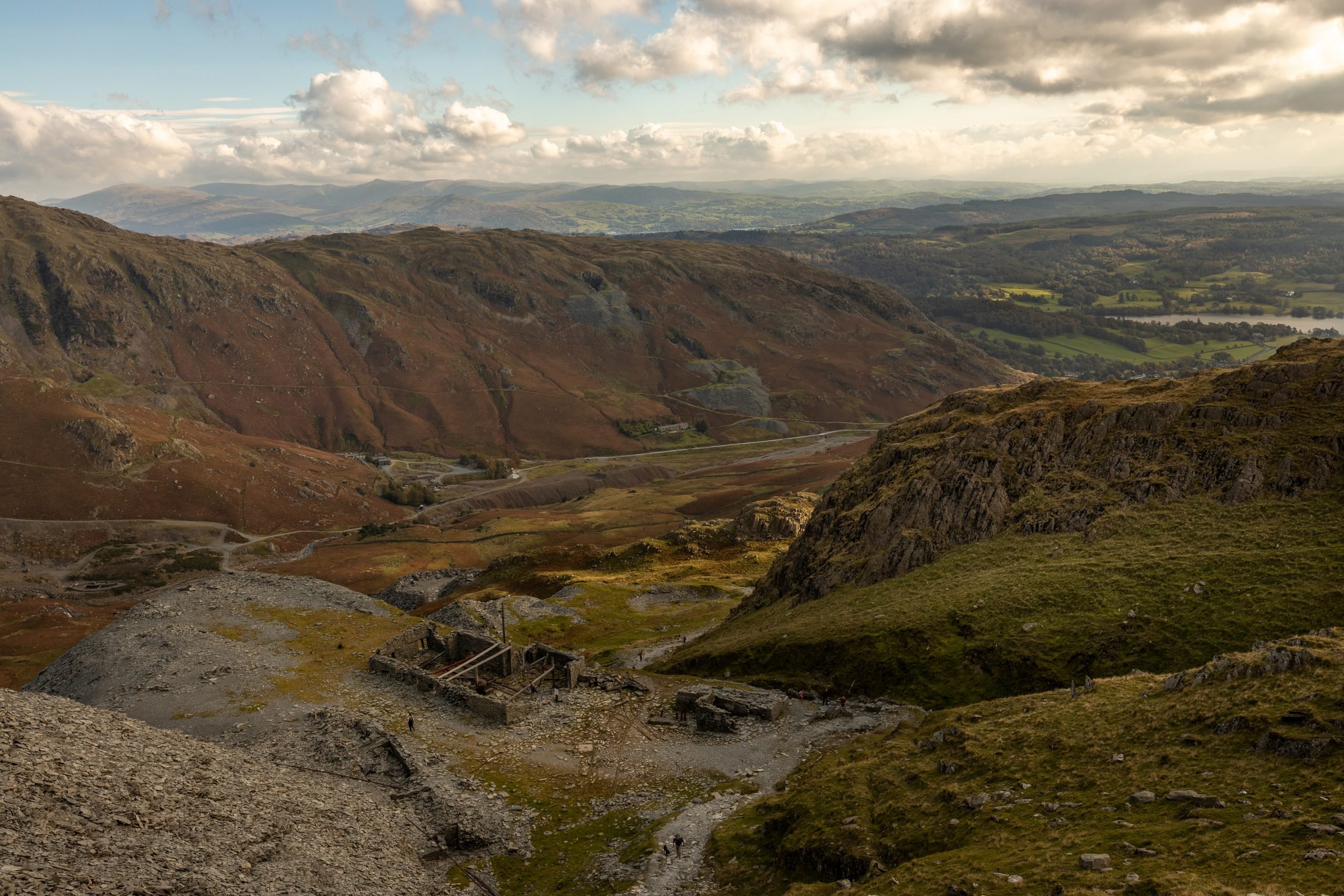 A view of the old mining buildings and the Coppermines Valley during a guided walk up the Old Man of Coniston in the Lake District