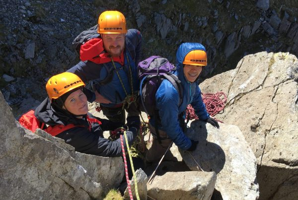 Scramblers waiting to start the crux of the Dolmen Ridge on Glyder Face during a mountaineering course
