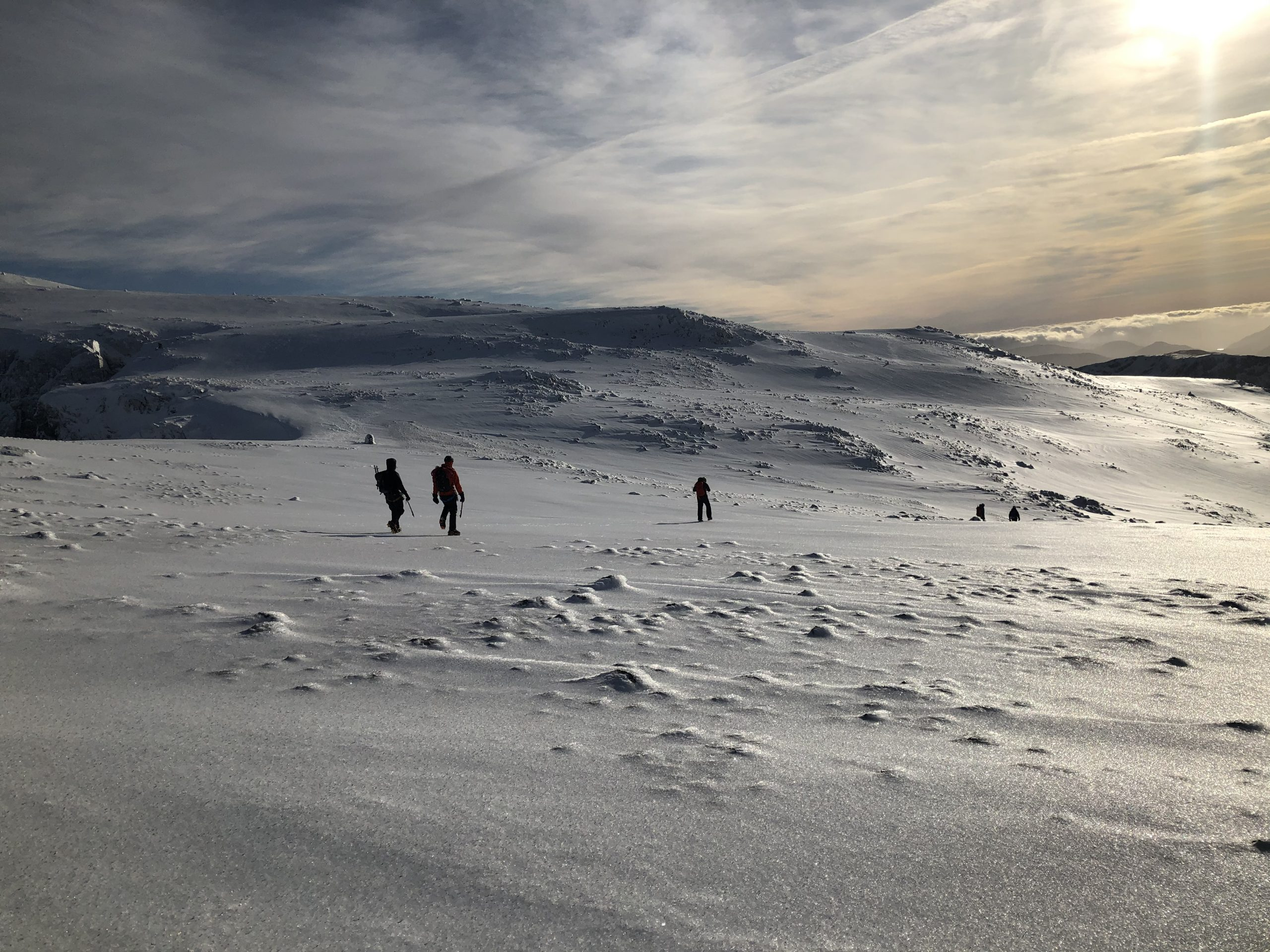 Descending the plateau of Ben Nevis in winter after climbing Ledge Route on a winter mountaineering course