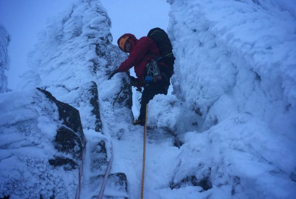"A climber leads the way up through the ""fingers"" of Fingers Ridge in the Cairngorms"