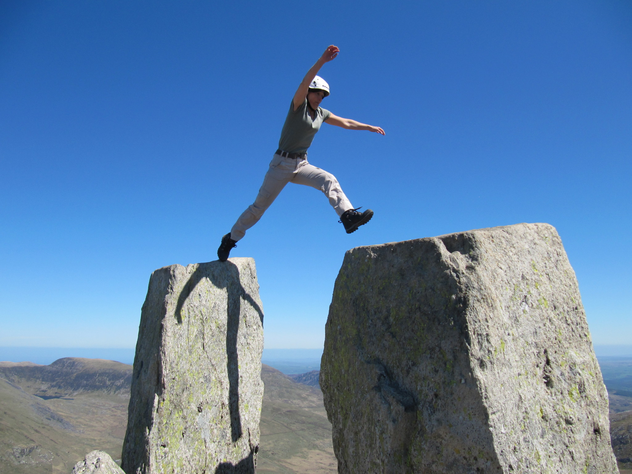 """Jumping between Adam and Eve on the summit of Tryfan after scrambling up the North Ridge on a course in Snowdonia"""" width="""