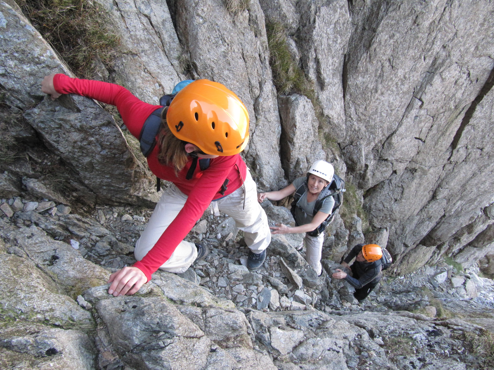 """During an introduction to scrambling course in Snowdonia, three scramblers climb Bristly Ridge, Glyder Fach, continuing from the north ridge of Tryfan"""" width="""