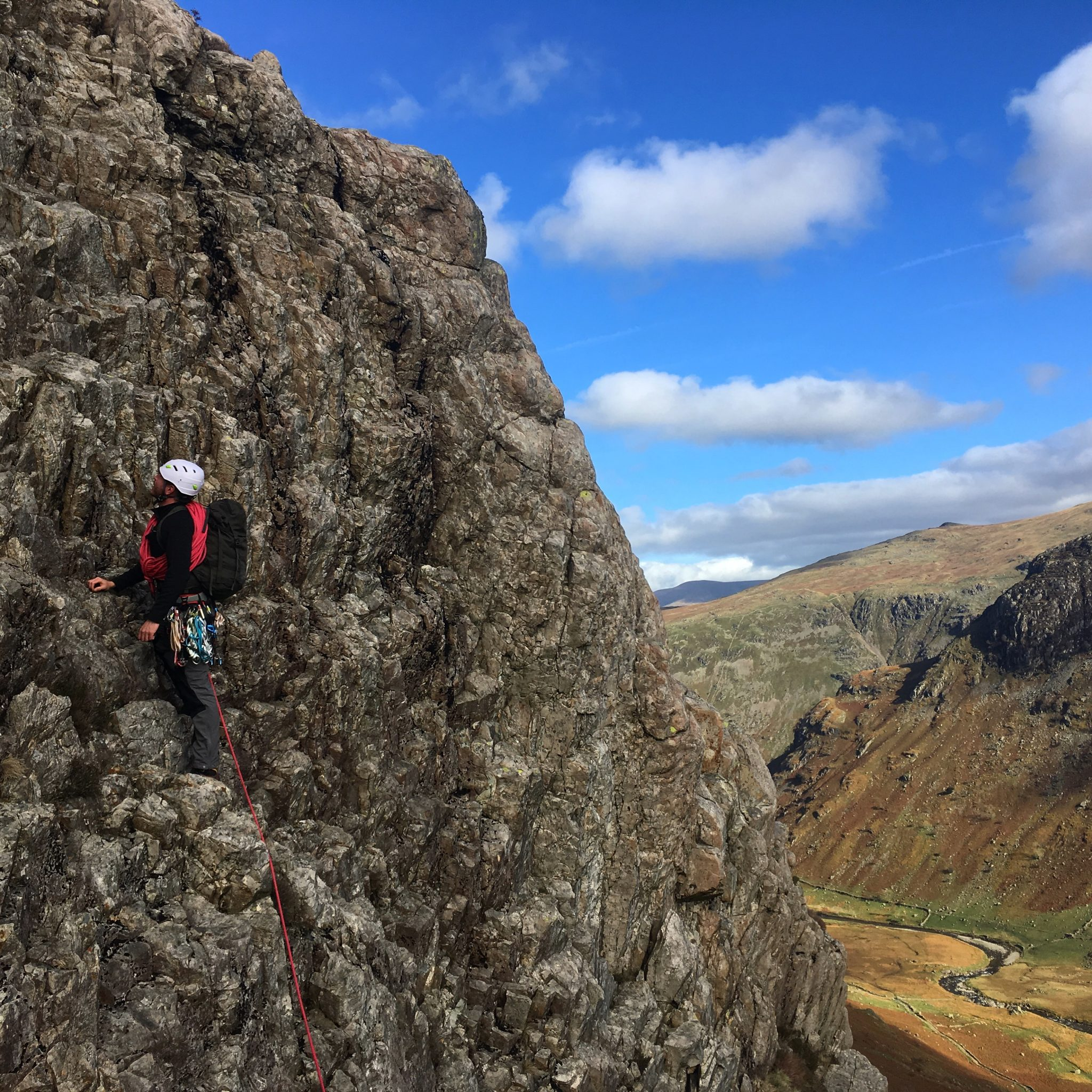 A climber practices his leading technique on Cam Crag Ridge during a scrambling course in the Lake District