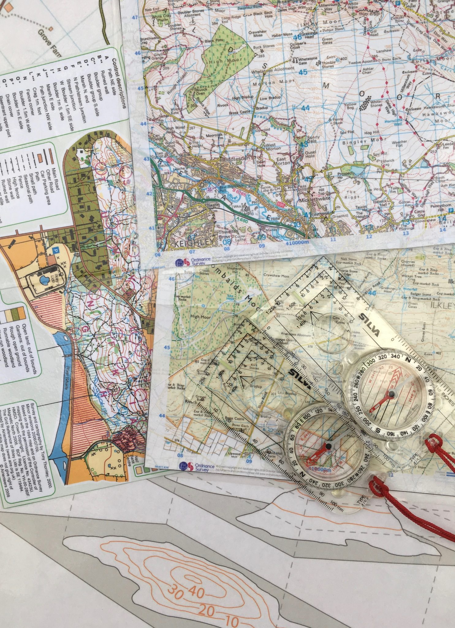Maps, compasses and other tools to teach map reading and navigation on a course such as NNAS Bronze navigation course in Yorkshire