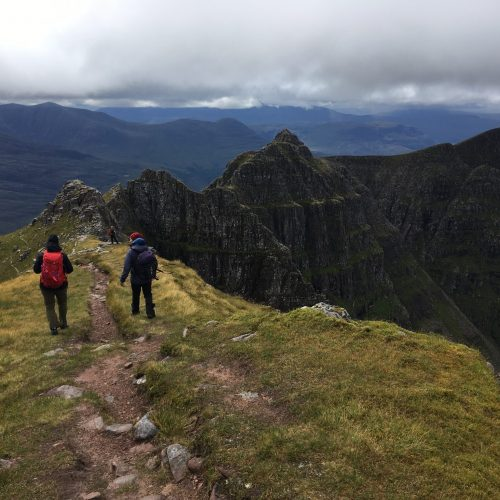 Walkers approaching the pinnacles on Liathach during a mountaineering course