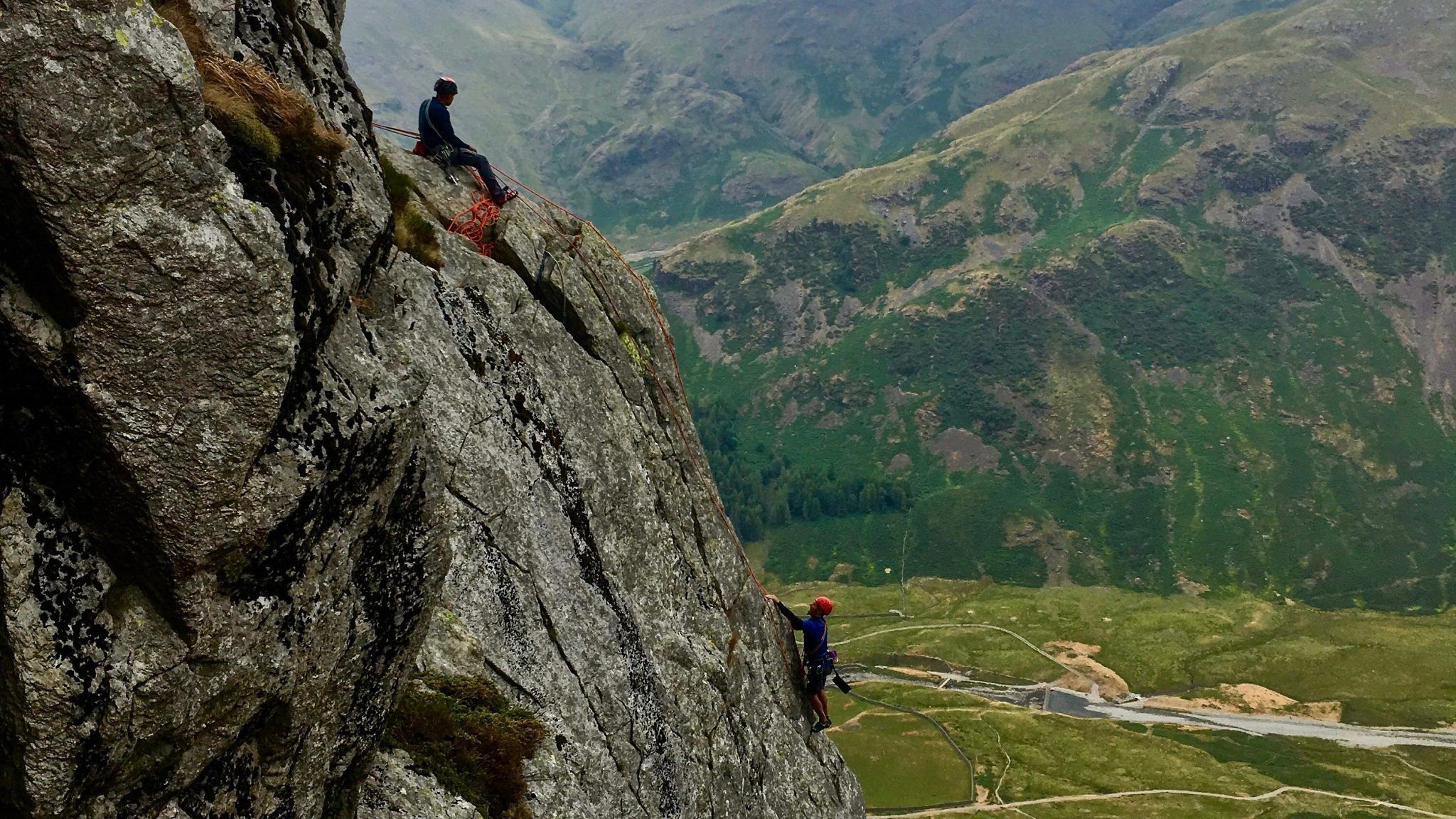 Rock climbers high up on Gimmer Crag in the Lake District