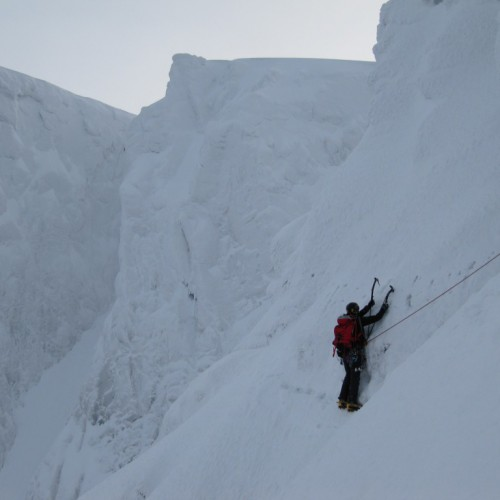 Climber on the Eastern Traverse, Tower Ridge, Ben Nevis in deep snow conditions