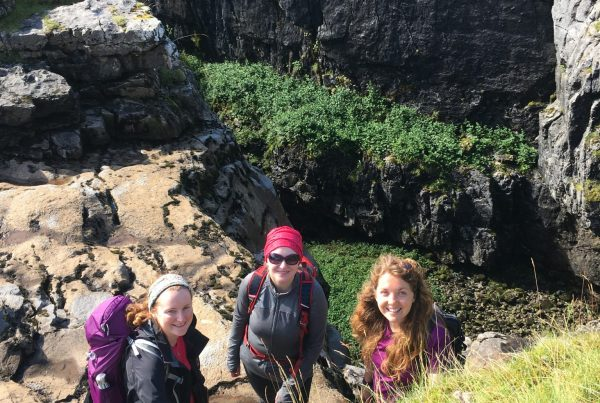 A walking group explore Hull Pot in the Yorkshire Dales during one of our guided mountain walks