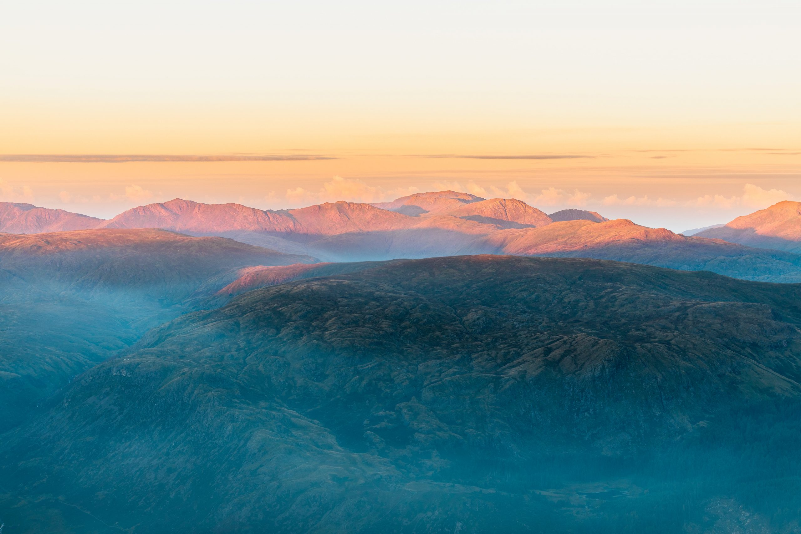 The central fells at dawn viewed from Helvellyn during a guided walk in the Lake District