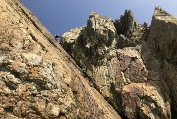 A climber 'tops out' after climbing Truant at Rhoscolyn on Anglesey
