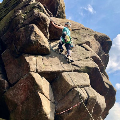 The hanging groove of the classic route Flying Buttress at Stanage during a Learn to Lead rock climbing course in the Peak District