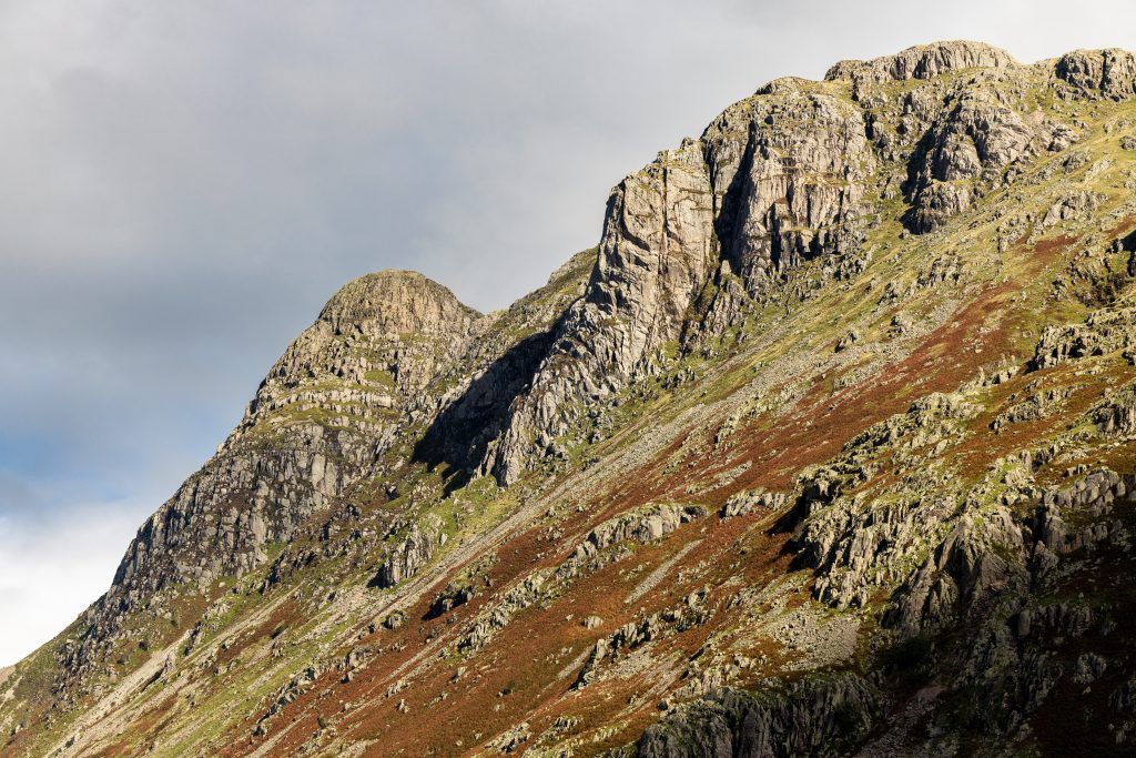 Gimmer Crag and Pike of Stickle, one of the Langdale Pikes, seen during a guided mountain walk in the Lake District