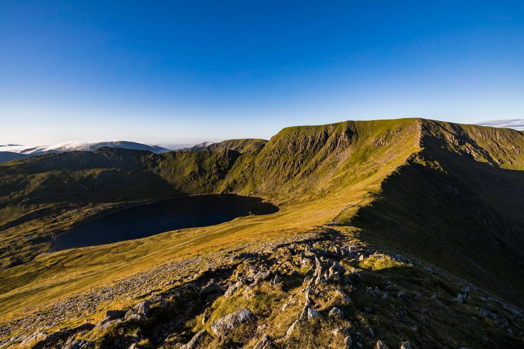 Helvellyn with Striding Edge, Swirral Edge and Red Tarn - a great view for a guided walk in the Lake District
