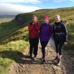 Three walkers enjoy the views from Pen y Ghent during a guided walk of the Yorkshire Three Peaks
