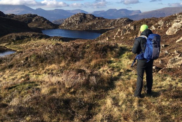 A student learns to read contour lines during one of our mountain navigation courses in Snowdonia