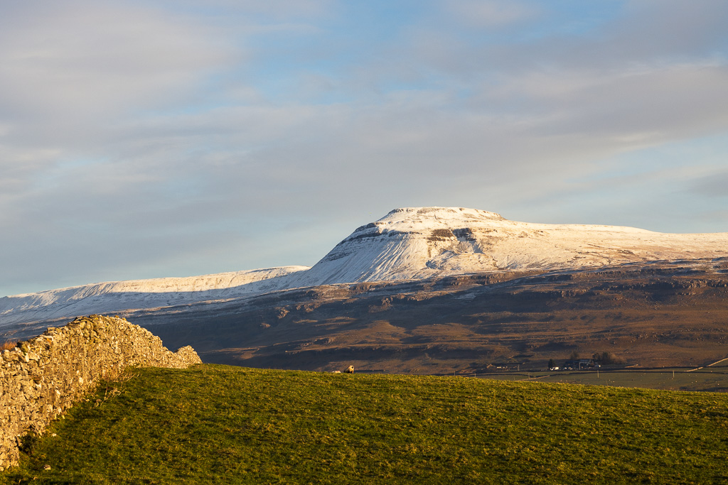 Ingleborough, one of the Yorkshire Three Peaks in the Yorkshire Dales, in winter with a beautiful topping of snow.