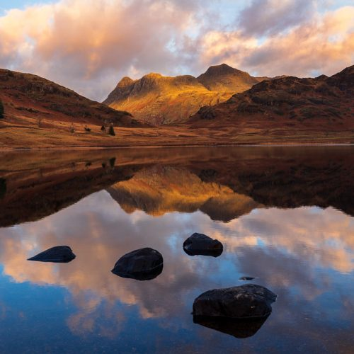 The Langdale Pikes in the Lake District, seen from Blea Tarn in the early morning