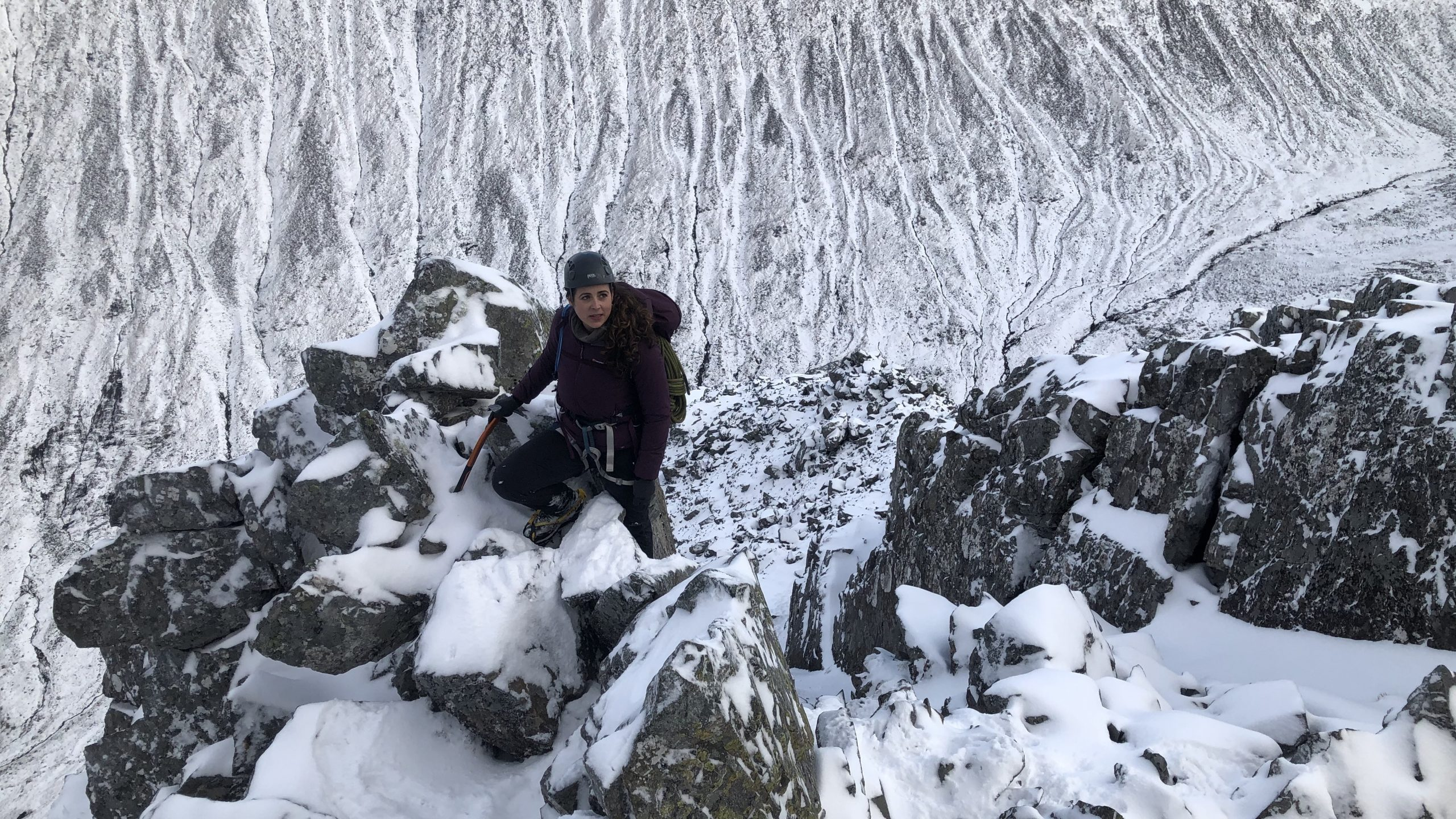 Looking down Ledge Route high up on Ben Nevis during a winter mountaineering courses in Scotland
