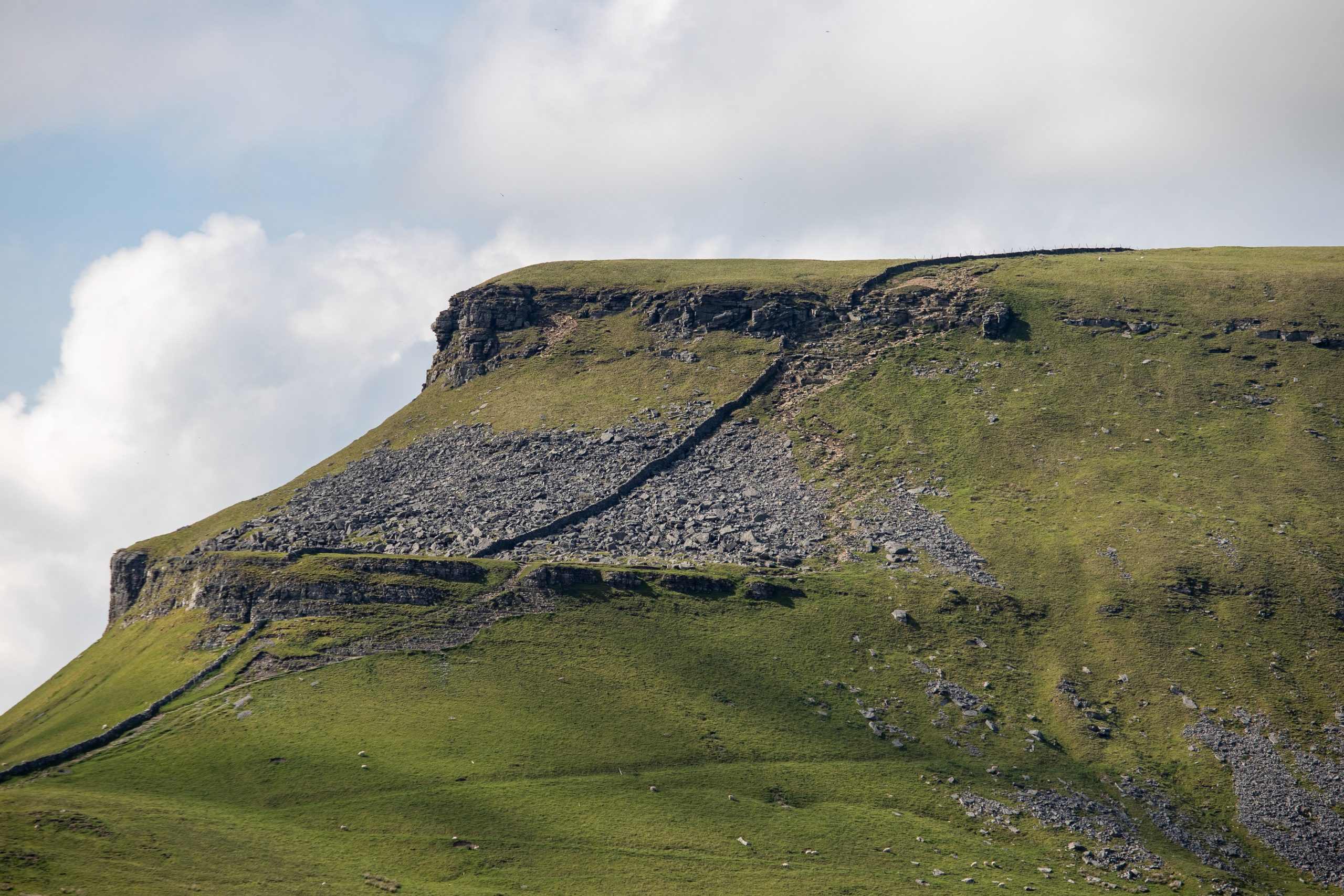 A close up of the steep rocky scramble section on the final approach to the summit of Pen y Ghent in the Yorkshire Dales