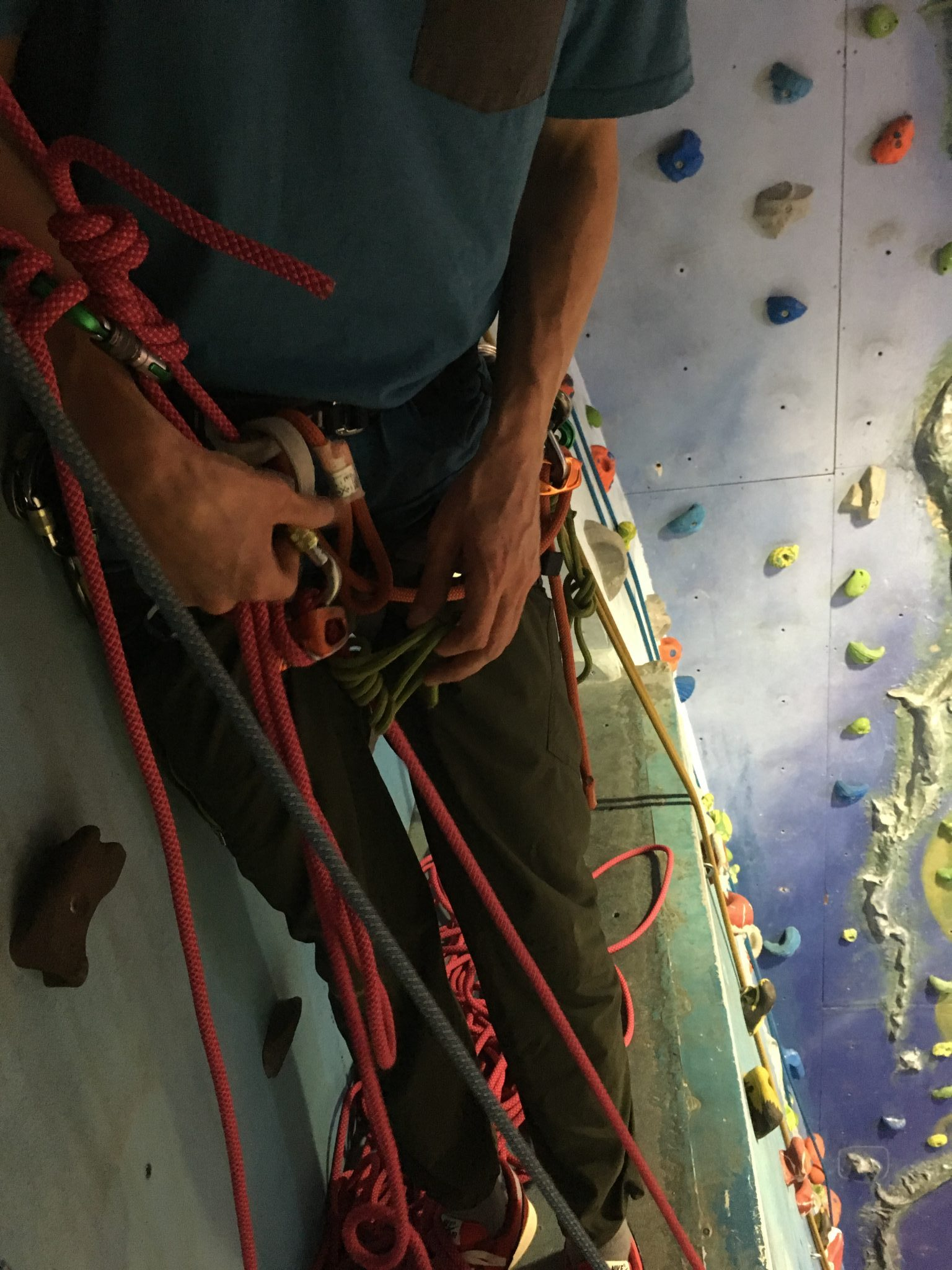 A climber attaches a prussic loop to his rope during a self-rescue course in the Lake District
