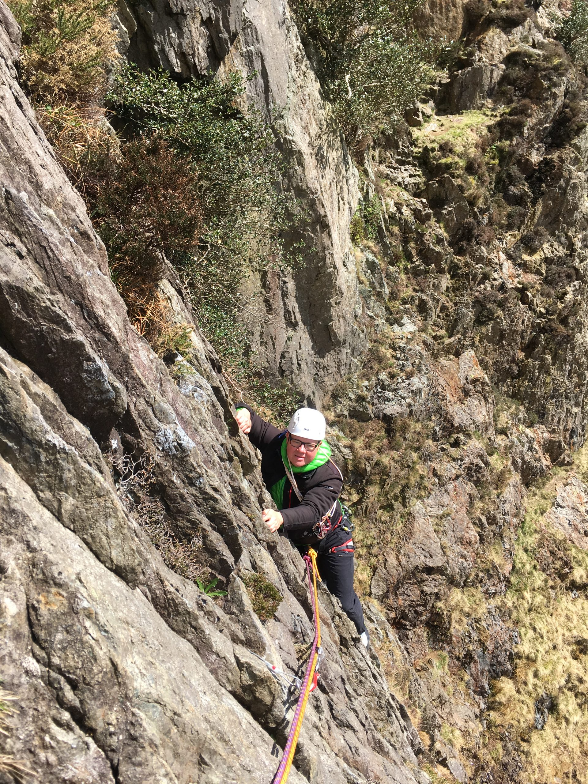 A climber seconding the classic route Crackstone Rib during a rock climbing course in Snowdonia