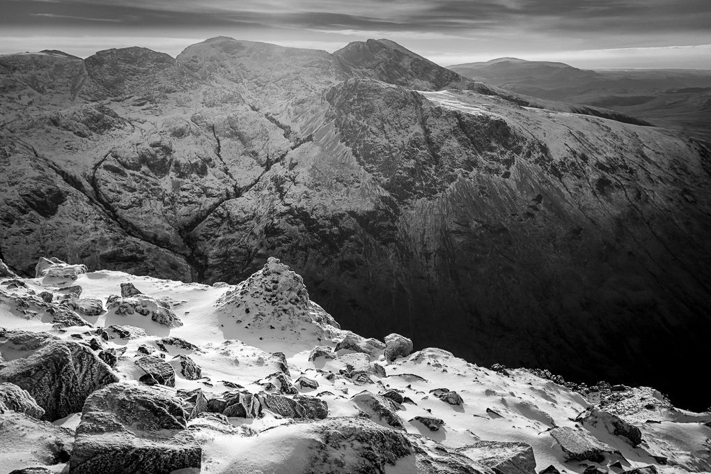 Scafell Pike in winter seen on a guided walk up Great Gable, with the dramatic shadow of Piers Gill splitting its sides