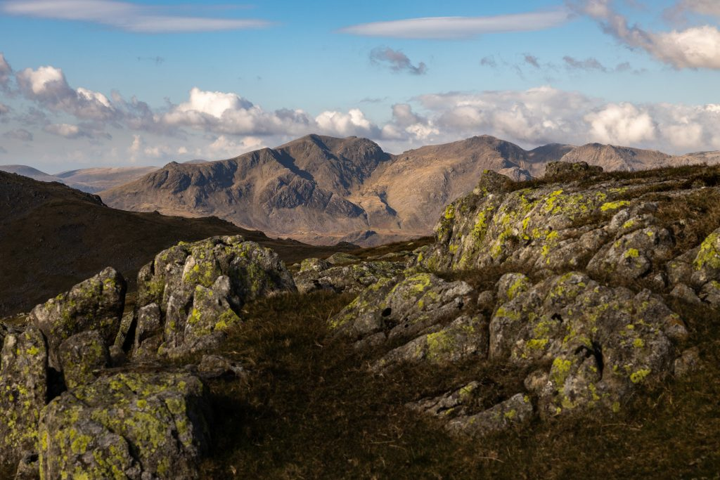 Scafell and Scafell Pike in the autumn sun seen from Swirl How during a guided walk up the Old Man of Coniston in the Lake District
