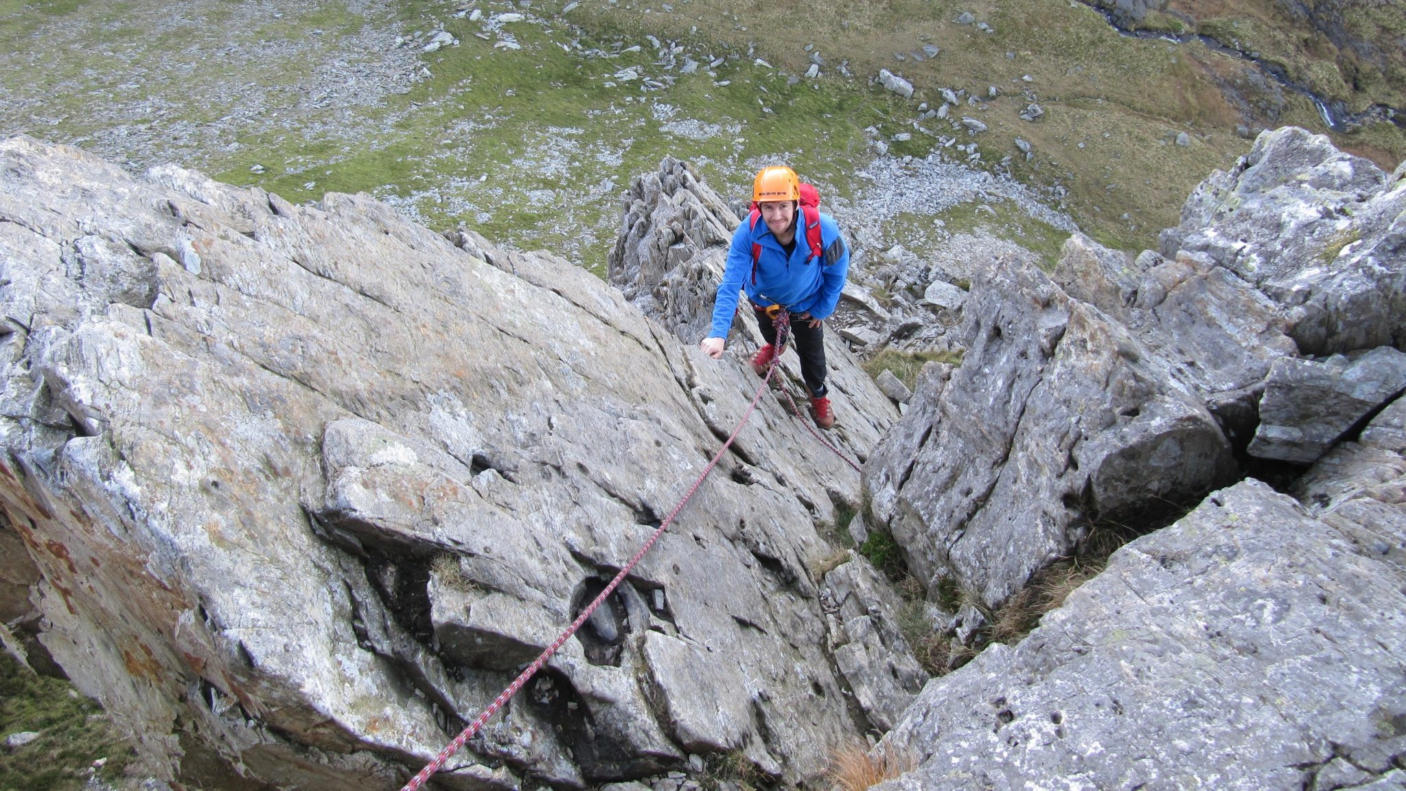 A climber moving up the Cneifion Arete during an advanced scrambling course in Snowdonia