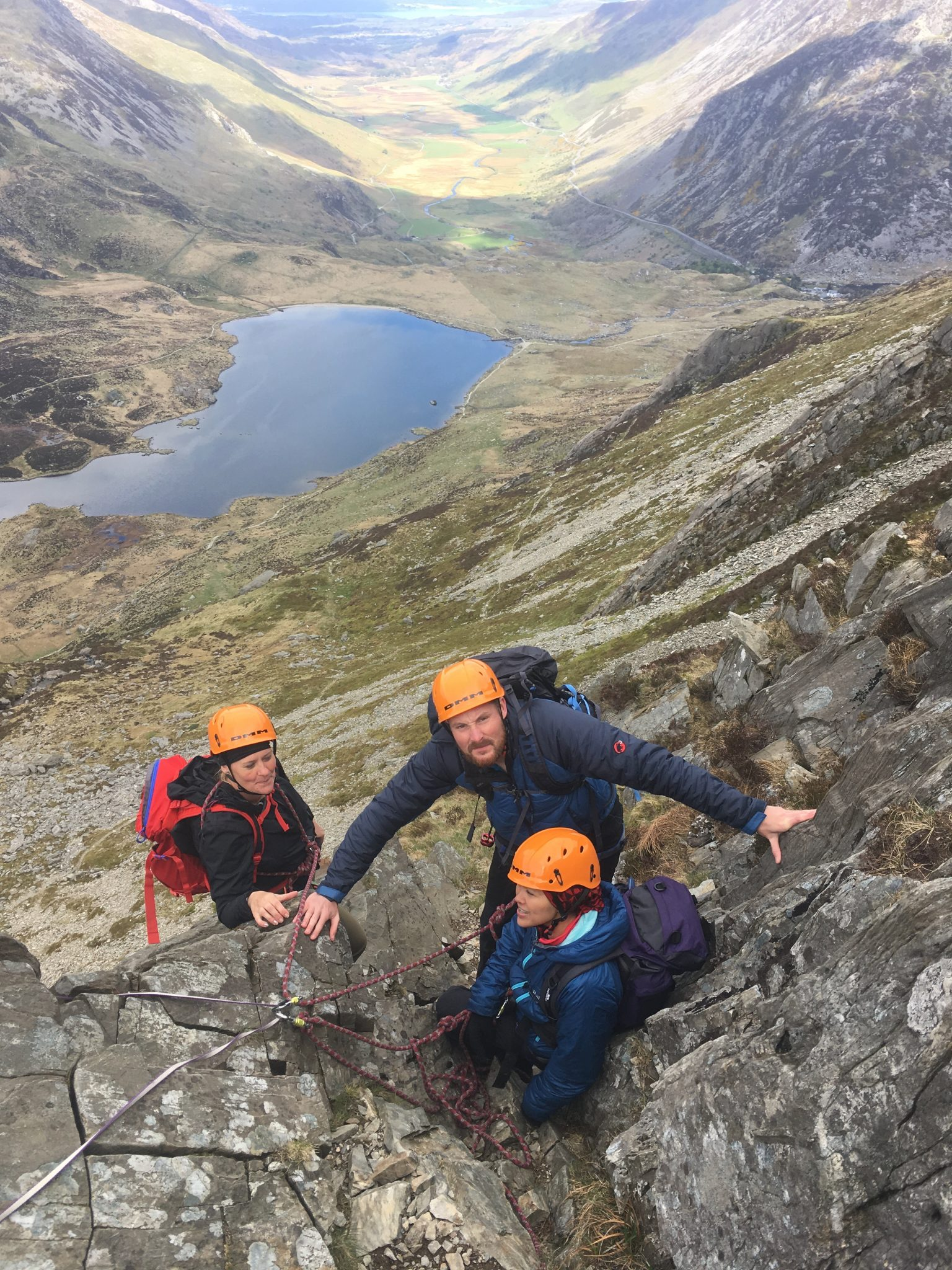 Three clients anchored safely to the rock part way up the Cneifion Arete during a learn to lead scrambling course in Snowdonia (also available in the Lake District and Scotland - Glencoe and Ben Nevis)