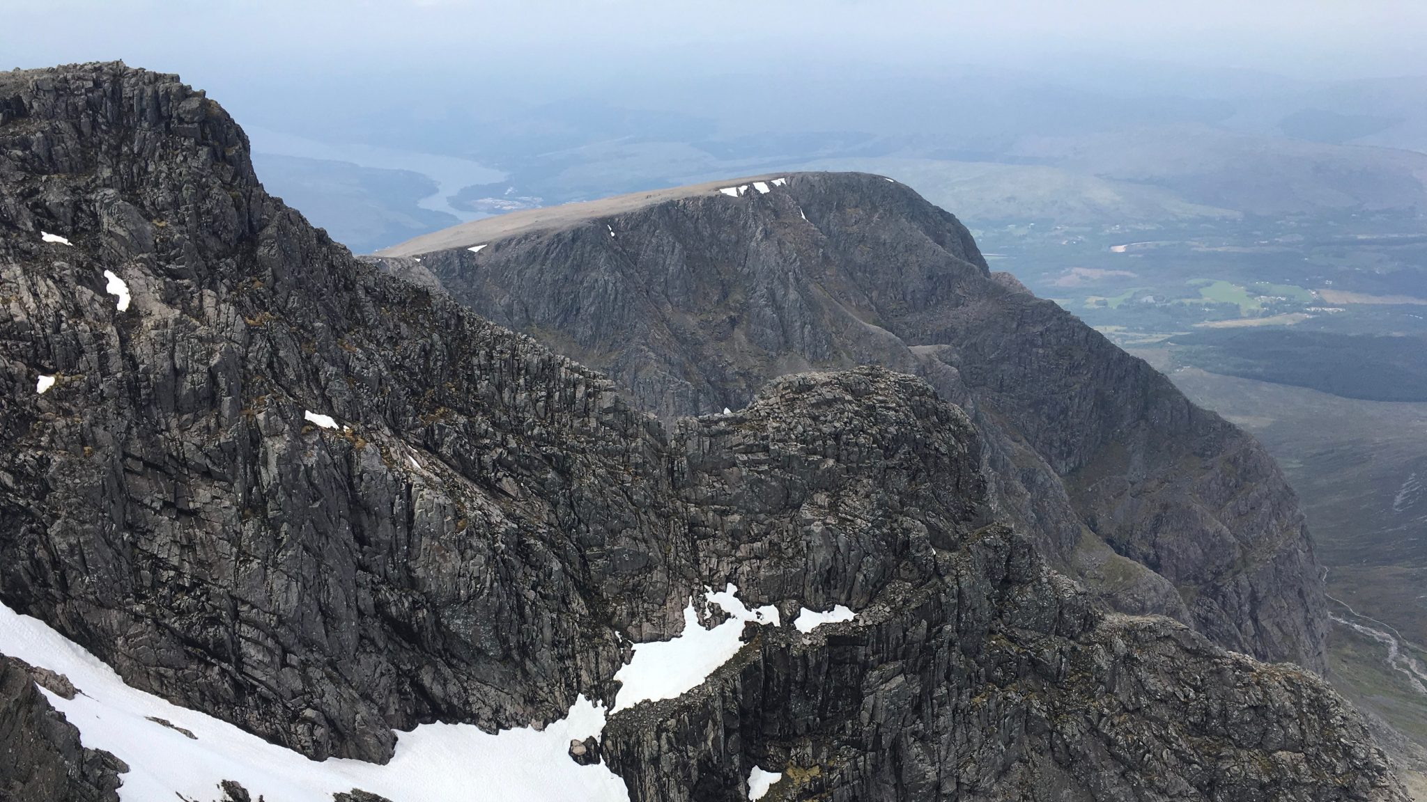 The spectacular profile of Tower Ridge and Tower Gap seen from the summit of Ben Nevis on a guided scrambling day