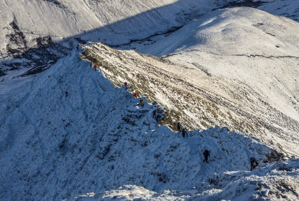 A busy day on Sharp Edge. Lots of climbers taking advantage of the conditions to practice their winter skills in the Lake District and make an ascent of this Grade 1 ridge on Blencathra.