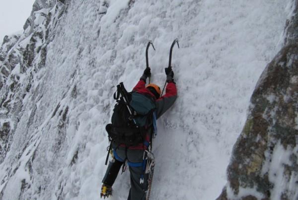 Climbing an ice pitch on Sickle, Ben Nevis