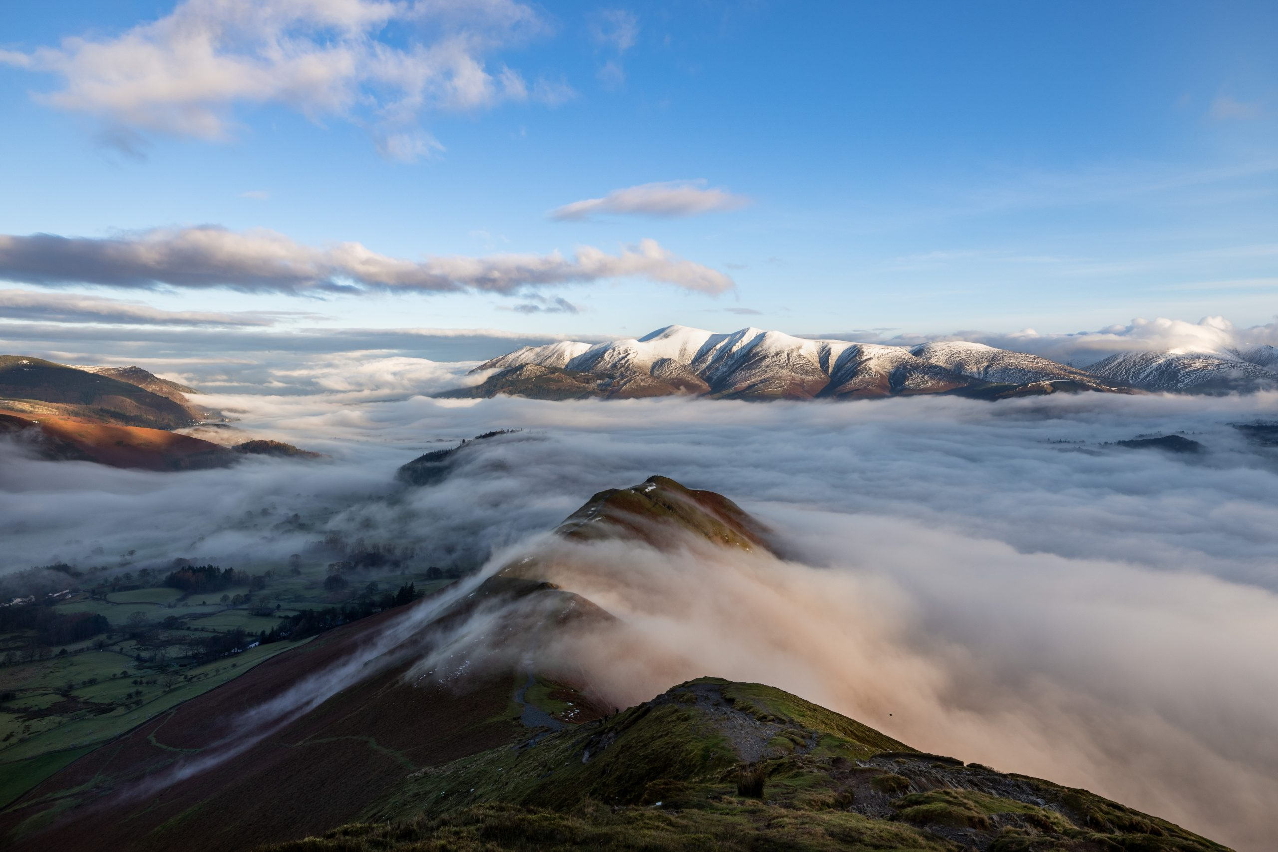 Skiddaw viewed from Catbells looking over a sea of low clouds - a typical view on guided winter walk or winter skill course in the Lake District