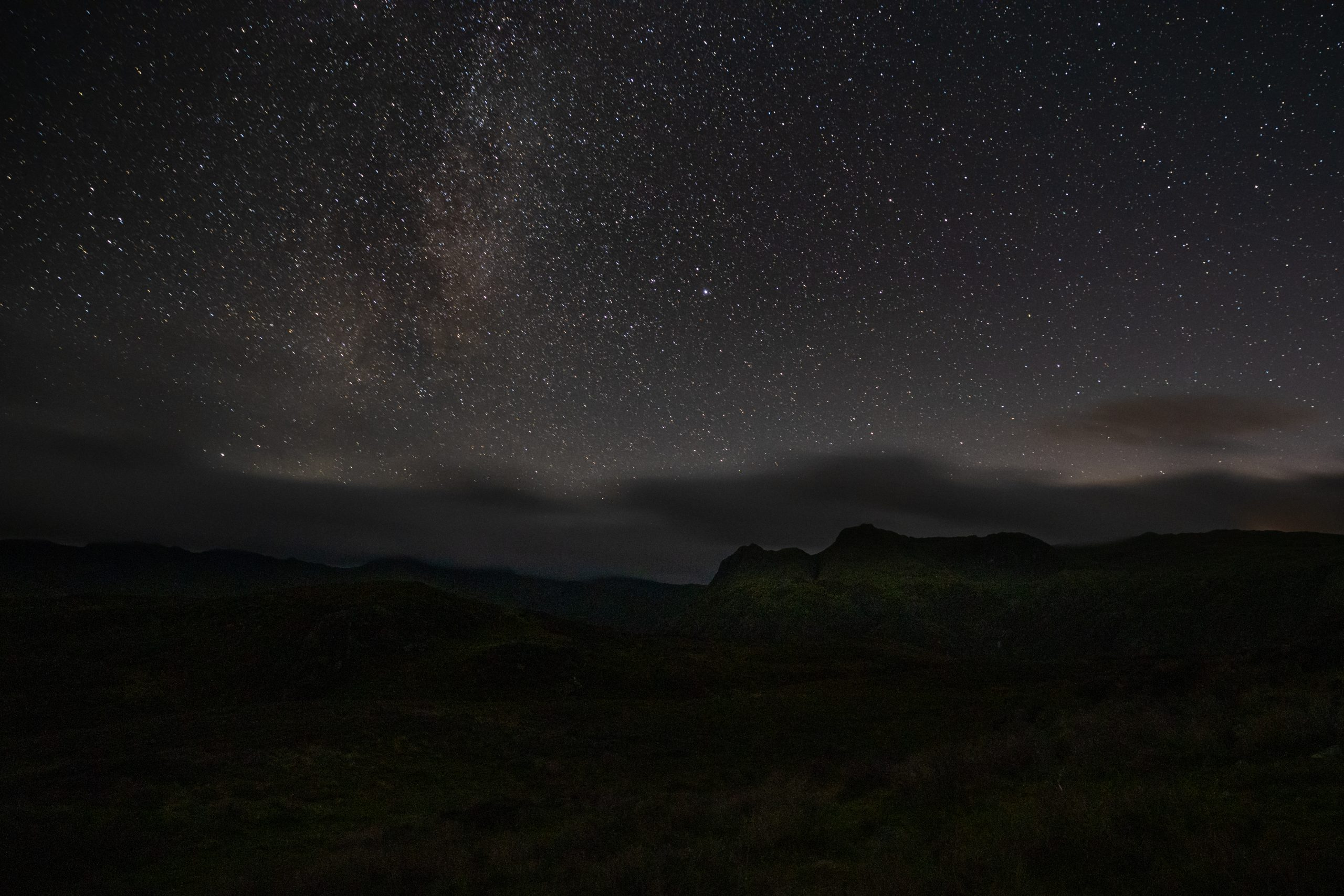 A starry night sky above the Langdale Pikes, seen on a guided night walk in the Lake District