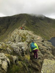 Scramblers finding the right way along Striding Edge on Helvellyn, during a guided scrambling day in the Lake District