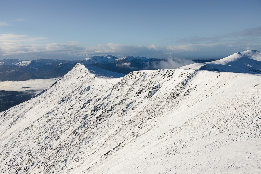 Walking on the summit ridge of Blencathra in the Lake District in winter.