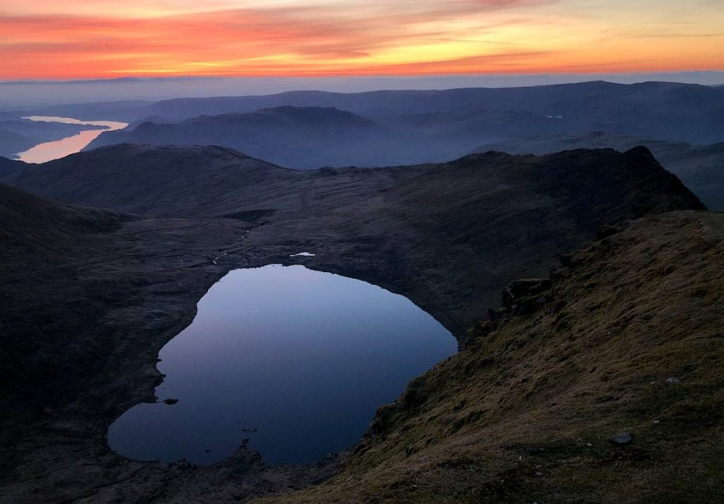 Sunrise seen from Helvellyn, with Striding Edge, Red Tarn and Ullswater in the view