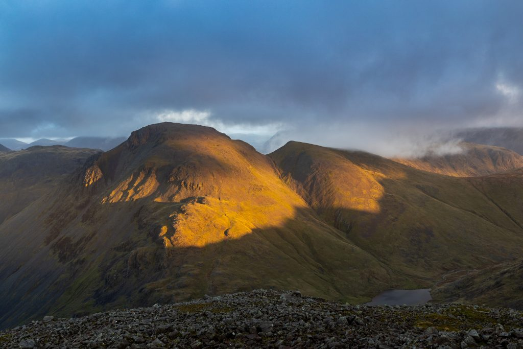 Golden sunrise hitting the slopes of Great Gable in the Lake District, with the prominent col or saddle of Windy Gap to its right