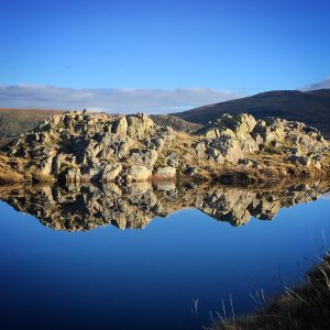 A beautiful reflection in a dead calm tarn on Rosthwaite Fell after a scramble up Cam Crag Ridge