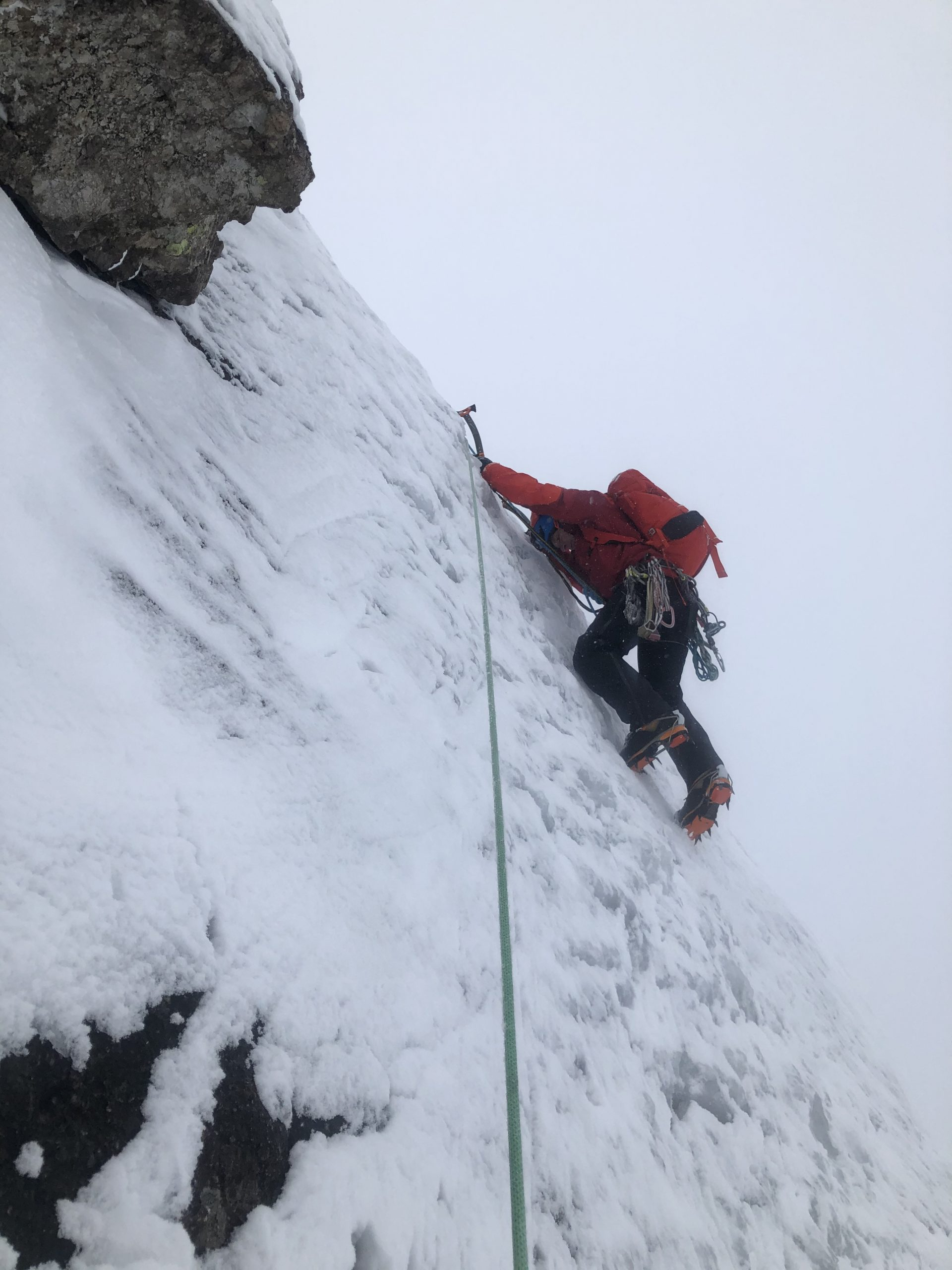 A climber balances on his front points while climbing The Curtain on Ben Nevis - typical of our winter climbing courses in the Cairngorms, Glencoe and Ben Nevis