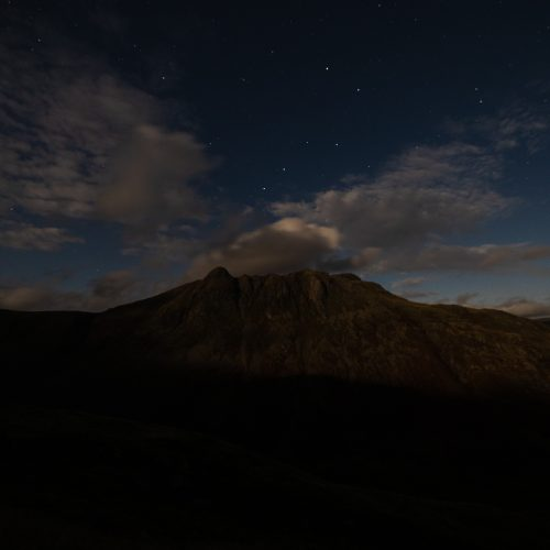 The Langdale Pikes at night, lit up by the moon, and with the unmistakeable stars of the Plough above, seen during a guided night walk in the Lake District