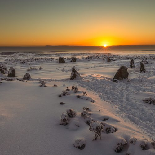 The Twelve Apostles stone circle on the top of Ilkley Moor at dawn on a snowy morning