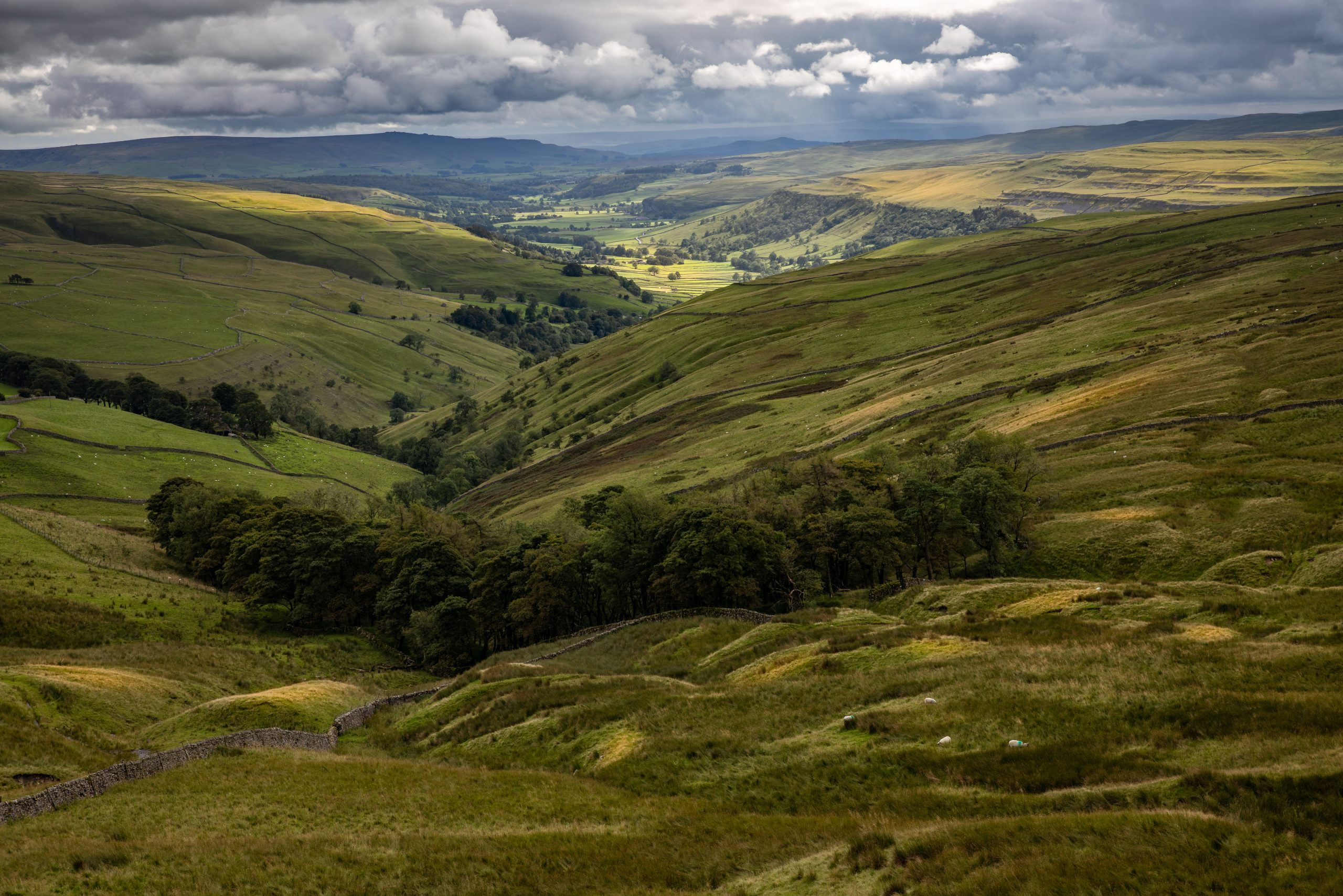 The view looking along Wharfedale from Cam Head above Kettlewell in the Yorkshire Dales all the way to the area of Ilkley