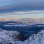 The sun begins to set over Borrowdale in the Lake District in winter