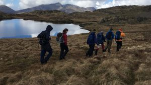 A group on a mountain walk in Snowdonia with a guide