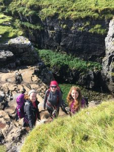 Three ladies explore the sides of Hull Pot on Pen y Ghent in the Yorkshire Dales