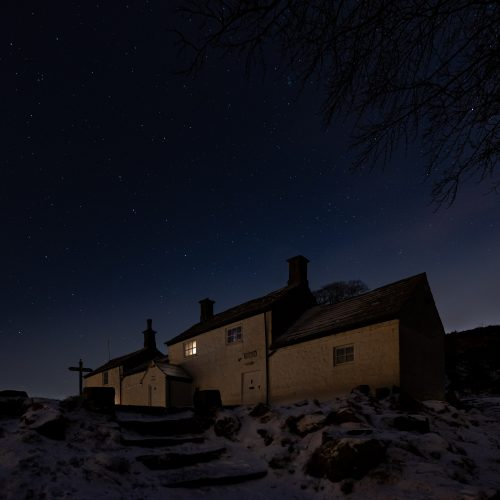 The White Wells Spa Cottage on Ilkley Moor on a winter's night under a starry sky